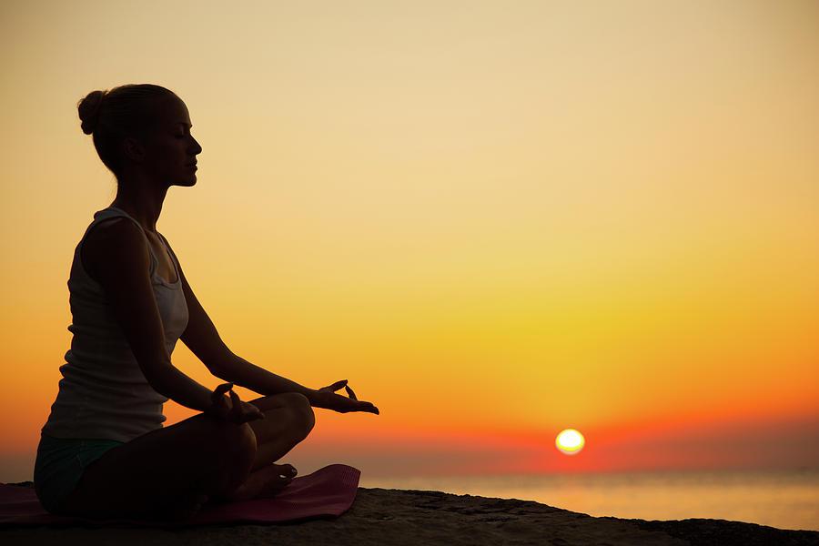 Woman Doing Meditation At Sunset Photograph by Emirmemedovski