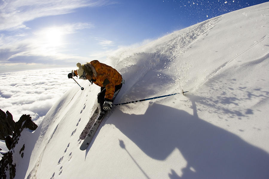 Action Photograph - Woman Skiing At Sunset, Chile by Gabe Rogel