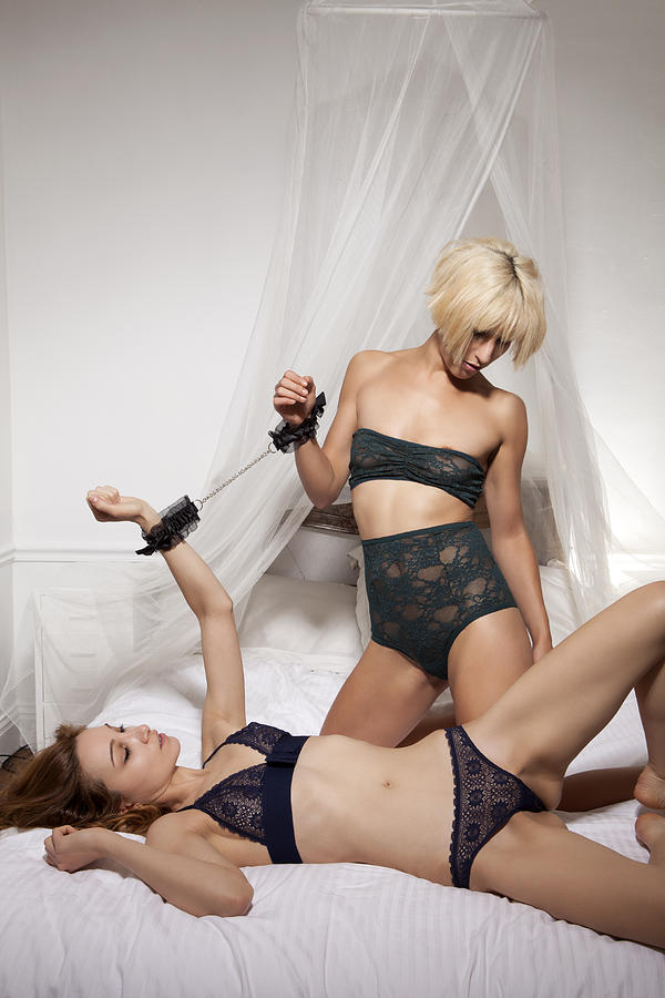 Women In Lingerie In Bed Together Photograph by Bdlm