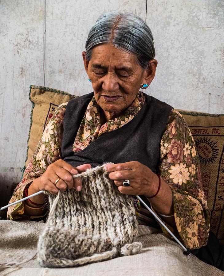 women tibetan refugee knitting photograph by guillaume