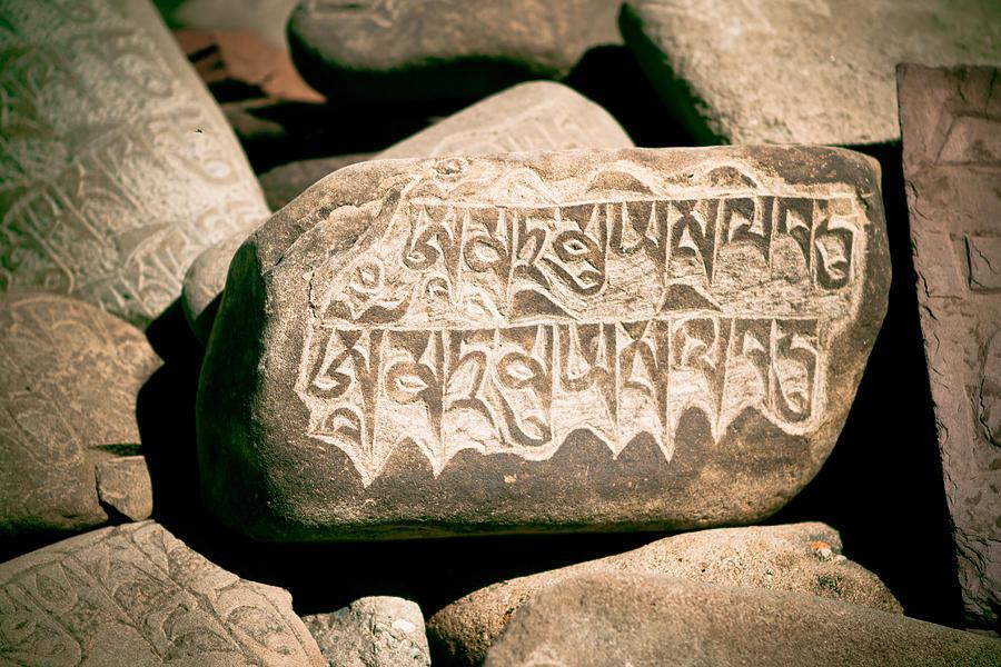Milarepa Photograph - writing on the Tibetan language and Sanskrit at stone by Raimond Klavins