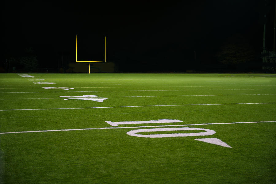 Yard Numbers And Line On American Football Field At Night
