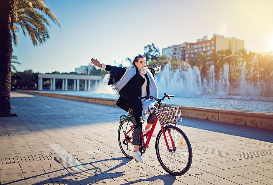 Young girl is riding a bicycle without hands in the park Photograph by Praetorianphoto