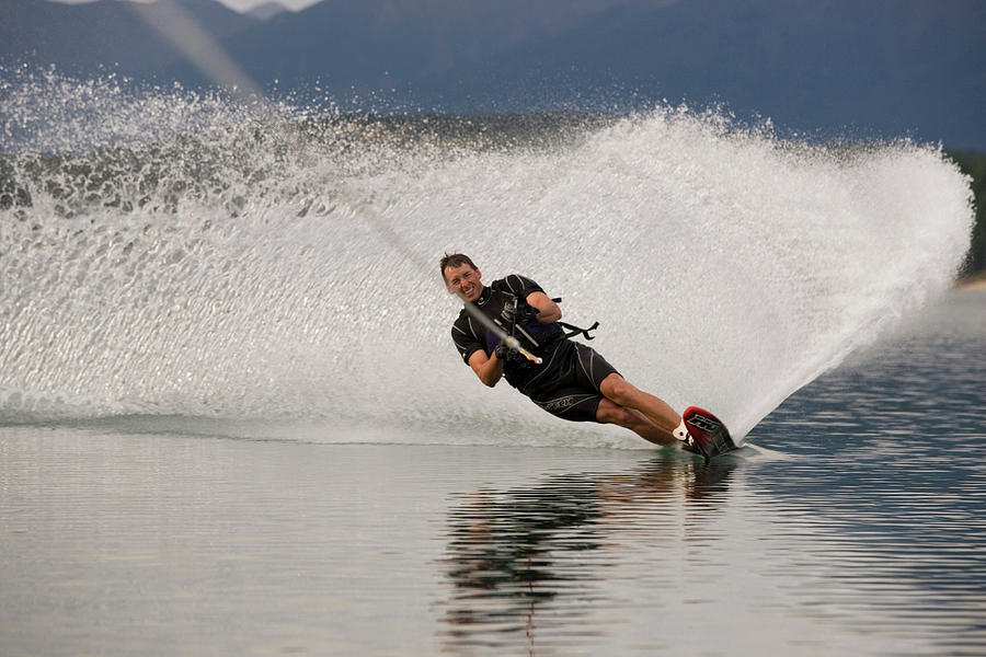 Action Photograph - Young Man Waterskiing On Lake Koocanusa by Henry Georgi
