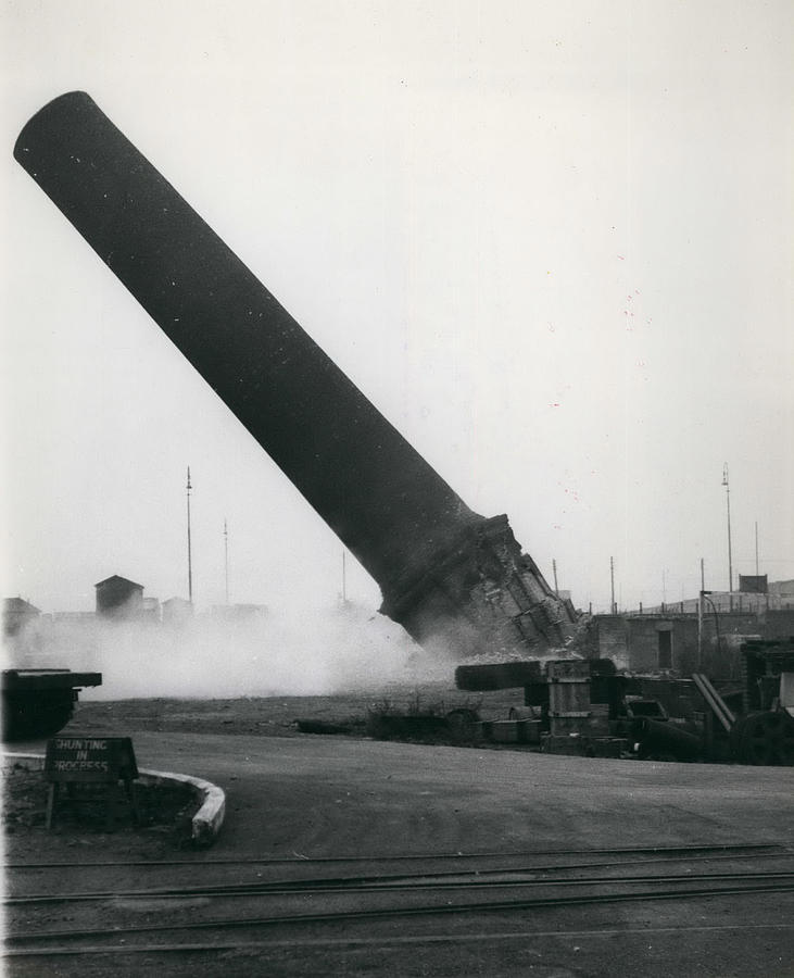 Retro Photograph - 100-foot Chimney Stack Demolished At Silvertown by Retro Images Archive