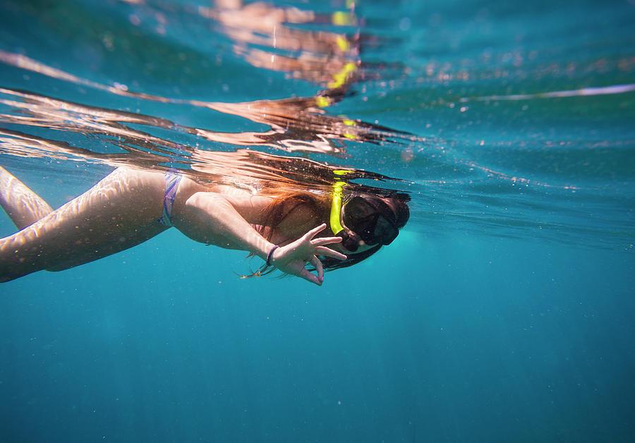 https://images.fineartamerica.com/images-medium-large-5/12-young-woman-snorkeling-in-ocean-konstantin-trubavin.jpg