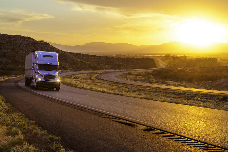 18-wheeler Tractor-trailer Truck On Interstate Highway At Sunset Photograph by Dszc