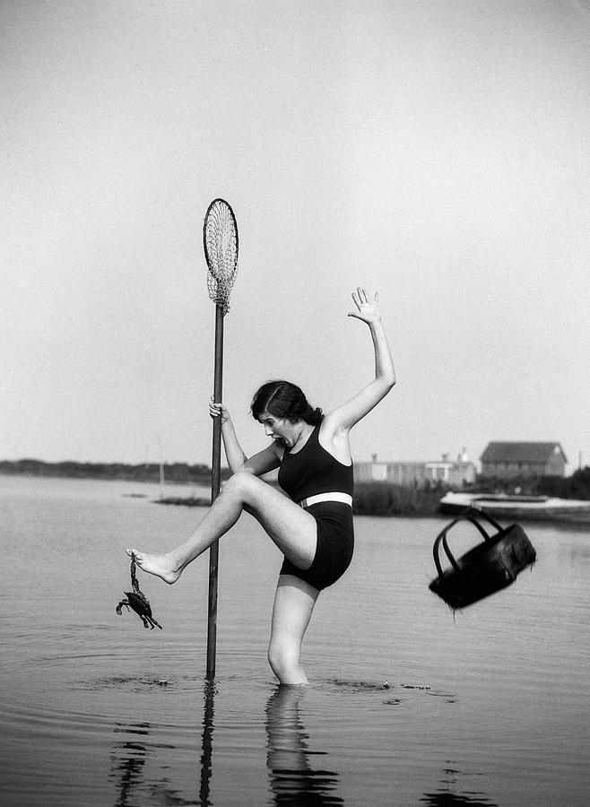 Vertical Photograph - 1920s Woman Crabbing Surprised By Crab by Vintage Images