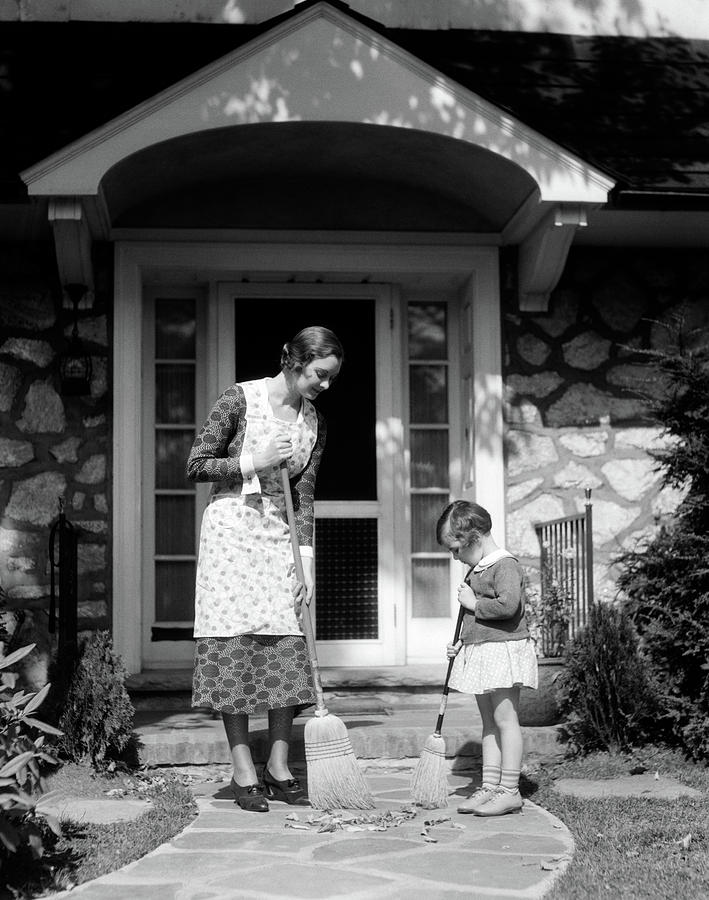 Vertical Photograph - 1930s Mother And Daughter Sweeping by Vintage Images