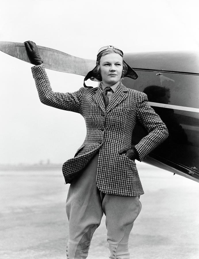 1930s Woman Aviator Pilot Standing Next