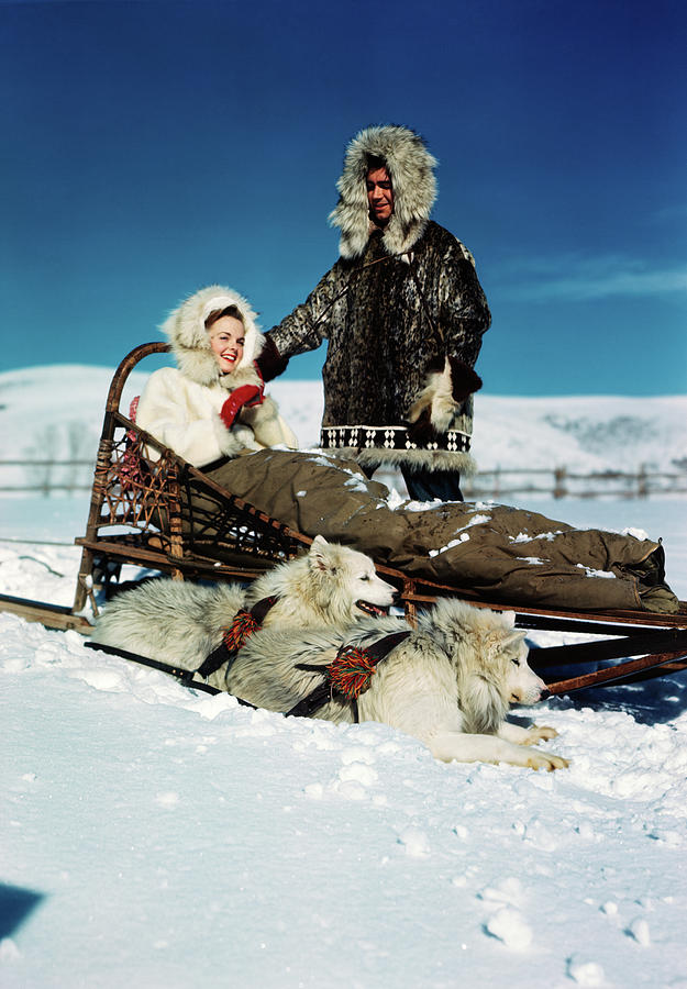 Vertical Photograph - 1940s 1950s Couple Wearing Fur Lined by Animal Images
