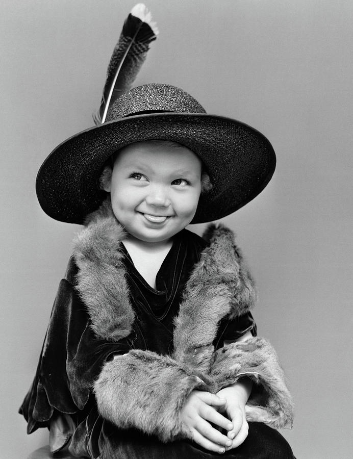 Vertical Photograph - 1940s Girl In Oversized Velvet Dress by Vintage Images
