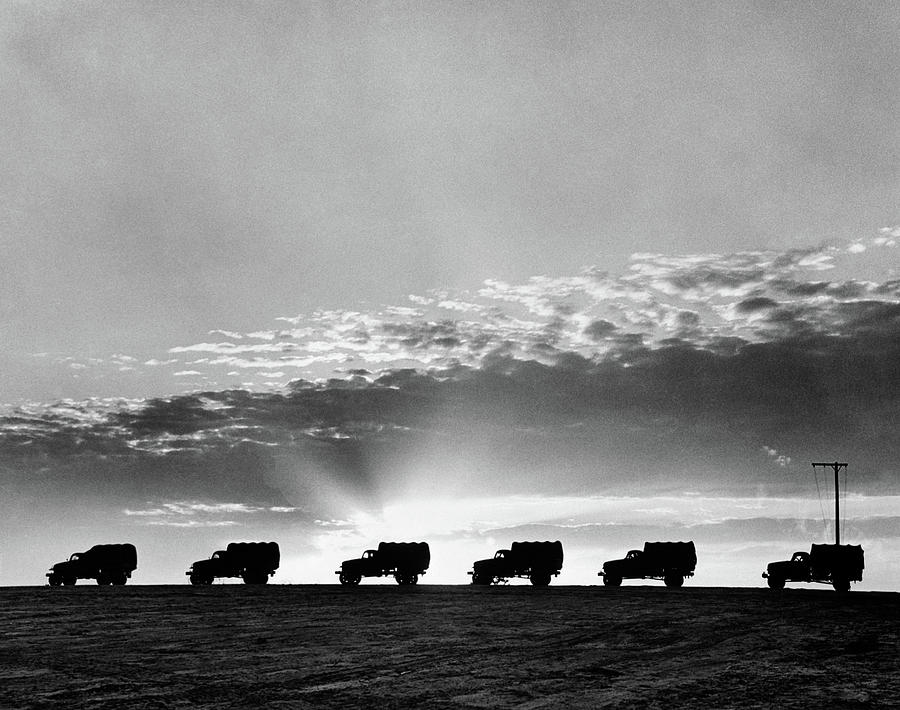 Horizontal Photograph - 1940s Line Of Anonymous Silhouetted by Vintage Images