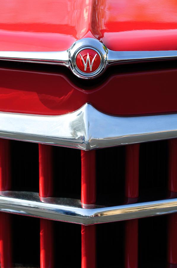 Emblem Photograph - 1950 Willys Overland Jeepster Hood Emblem by Jill Reger