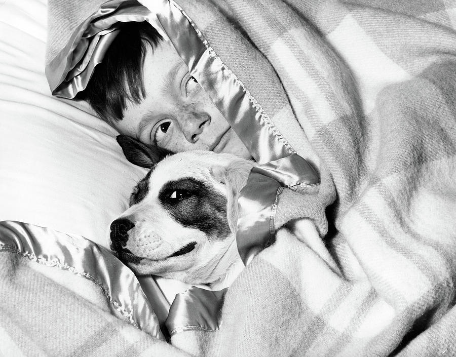 Horizontal Photograph - 1950s Boy Hiding Under Blanket In Bed by Vintage Images