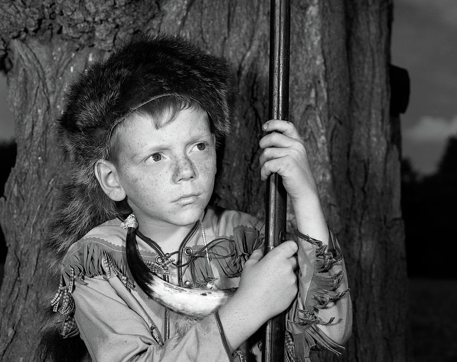 Horizontal Photograph - 1950s Boy Wearing Raccoon Skin Hat by Vintage Images