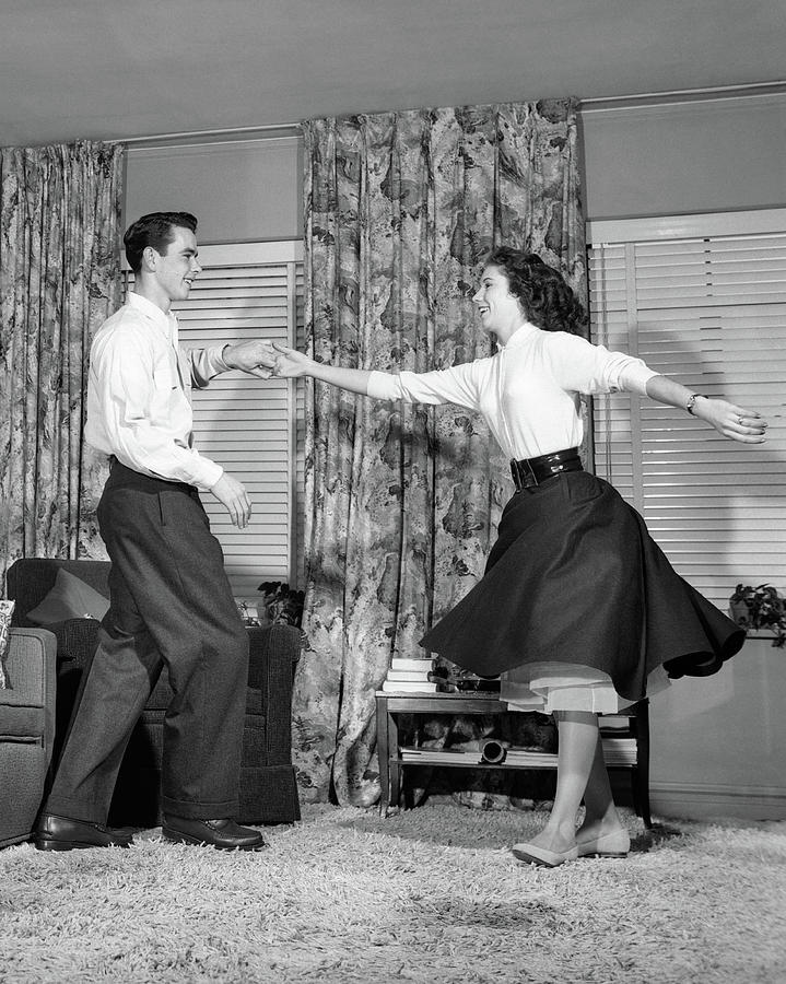 Vertical Photograph - 1950s Teen Boy And Girl Jitterbug by Vintage Images