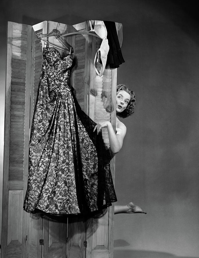 Vertical Photograph - 1950s Woman Peeking From Behind Screen by Vintage Images