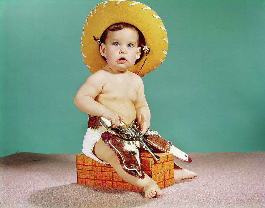 Horizontal Photograph - 1960s Baby Wearing Cowboy Hat by Vintage Images