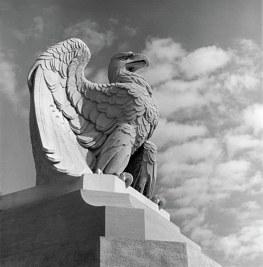Vertical Photograph - 1960s Eagle Statue Against Sky Clouds by Vintage Images