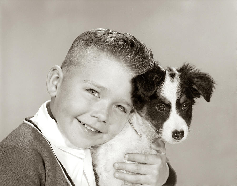 Horizontal Photograph - 1960s Portrait Of Smiling Boy Looking by Animal Images