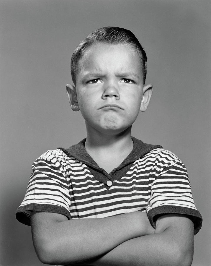 Vertical Photograph - 1960s Portrait Pouting Angry Boy Arms by Vintage Images