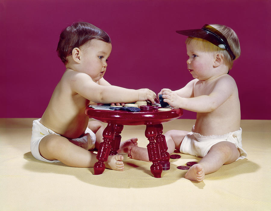 Horizontal Photograph - 1960s Two Babies Sitting At Red Stool by Vintage Images