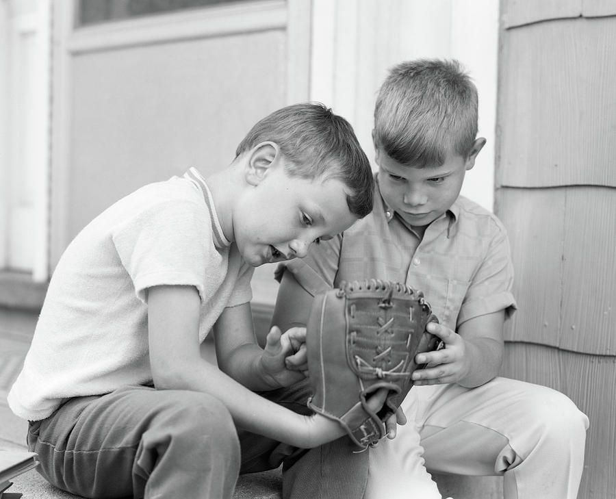Horizontal Photograph - 1970s Two Boys Seriously Inspecting New by Vintage Images