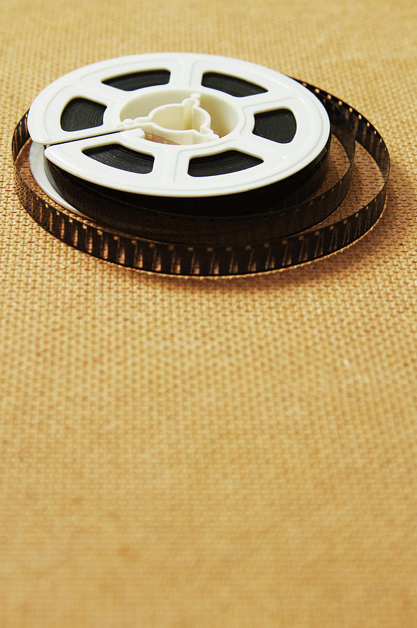 A Reel, Or Spool, Of 8mm Movie Film Photograph by Jon Schulte