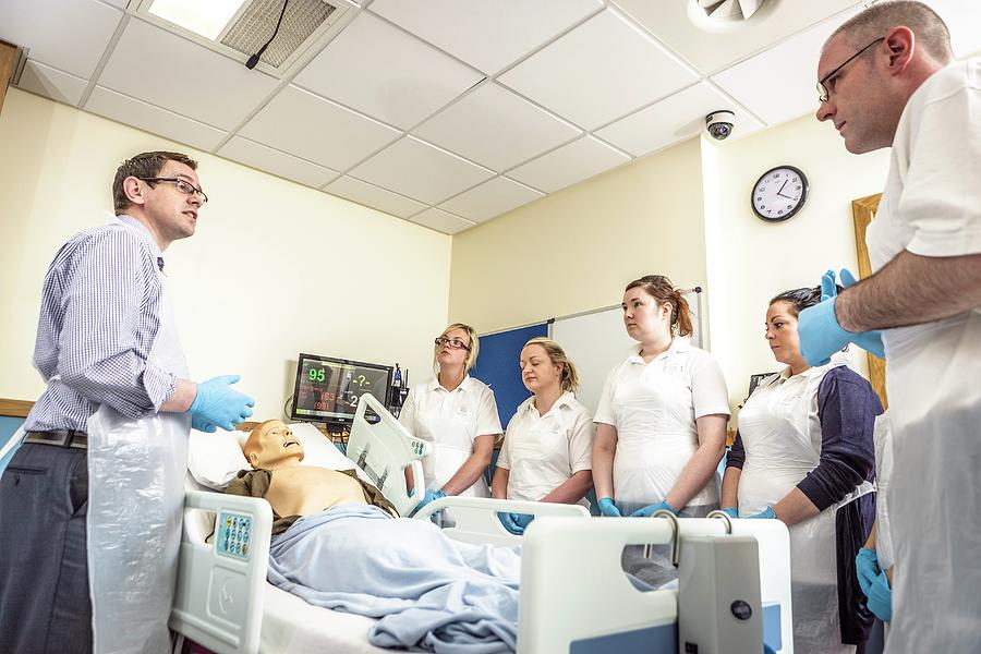 Small Group Of People Photograph - Acute Care And Resuscitation Training by Gustoimages