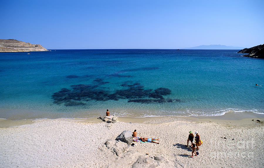Mykonos; Mikonos; Beach; Agrari; Greece; Hellas; Cyclades; Kyklades; Greek; Hellenic; Aegean; Island; People; Tourists; Islands; Sunbathing; Suntanning; Suntan; Tanning; Relaxing; Relaxation; Sand; Sea; Clear Water; Transparent Water; Holidays; Vacation; Travel; Trip; Voyage; Journey; Tourism; Touristic; Summer; Sunny; Blue; Sky Photograph - Agrari Beach by George Atsametakis
