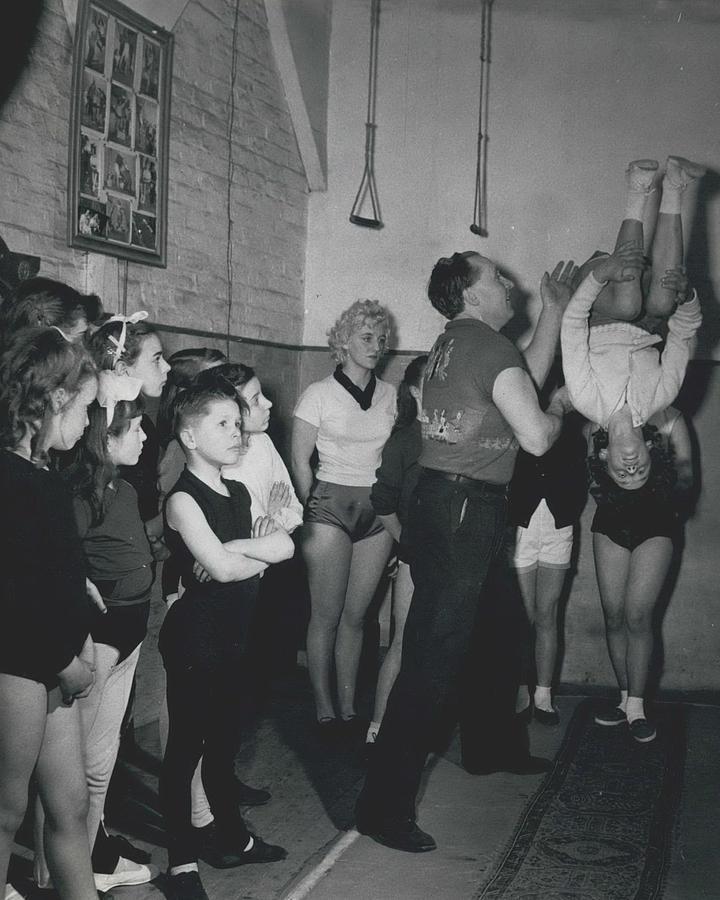 Retro Photograph - Aspiring Acrobats by Retro Images Archive