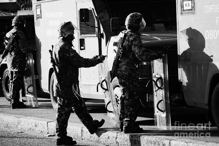 Northern Photograph - British Army Soldiers In Riot Gear On Crumlin Road At Ardoyne Shops Belfast 12th July by Joe Fox