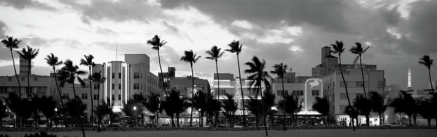 Color Image Photograph - Buildings Lit Up At Dusk, Ocean Drive by Panoramic Images
