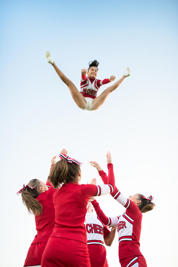 Cheerleaders Throw Up A Girl In The Air Photograph by Franckreporter