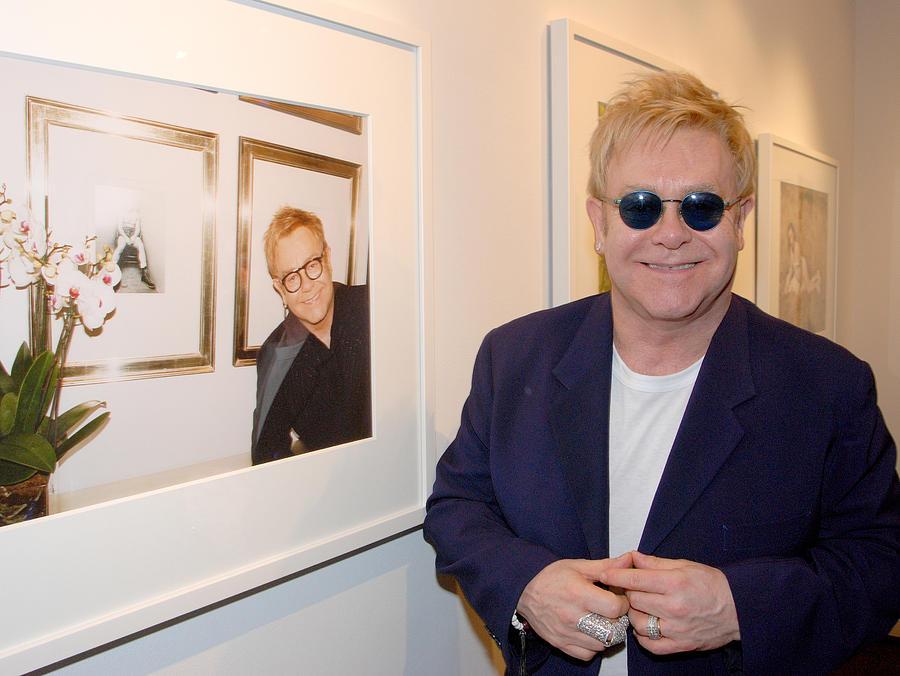 Celebrity Photograph - Elton watching Elton by Philip Shone