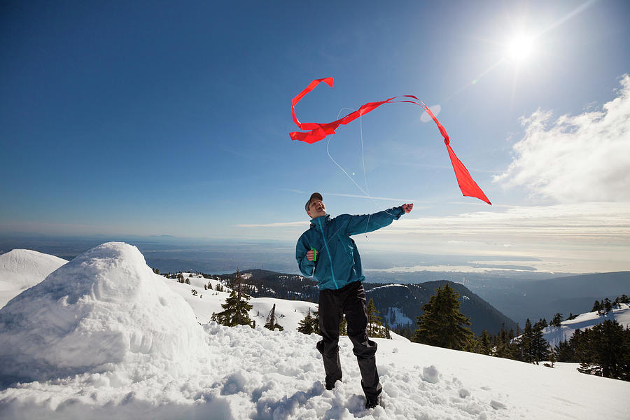 Full Length Photograph - Flying A Kite On A Snowy Mountain by Christopher Kimmel
