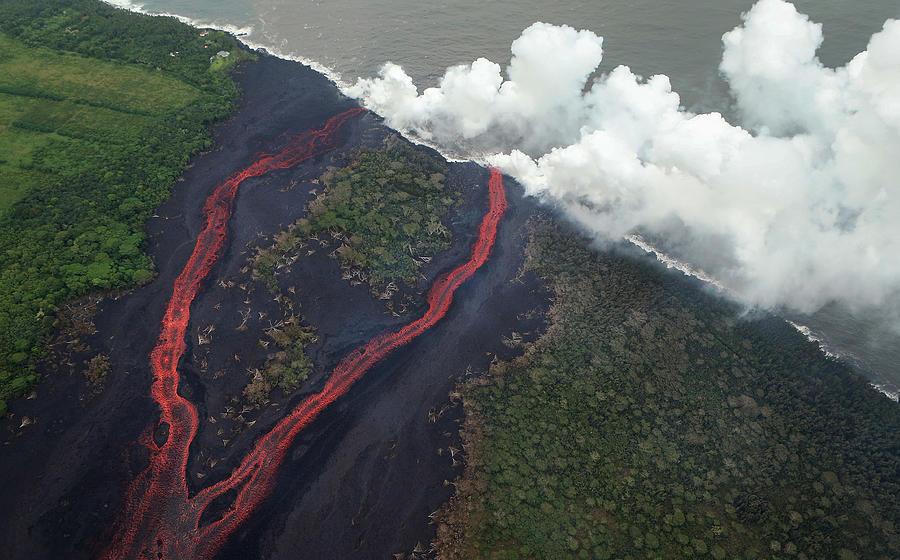 Hawaiis Kilauea Volcano Erupts Forcing Photograph by Mario Tama