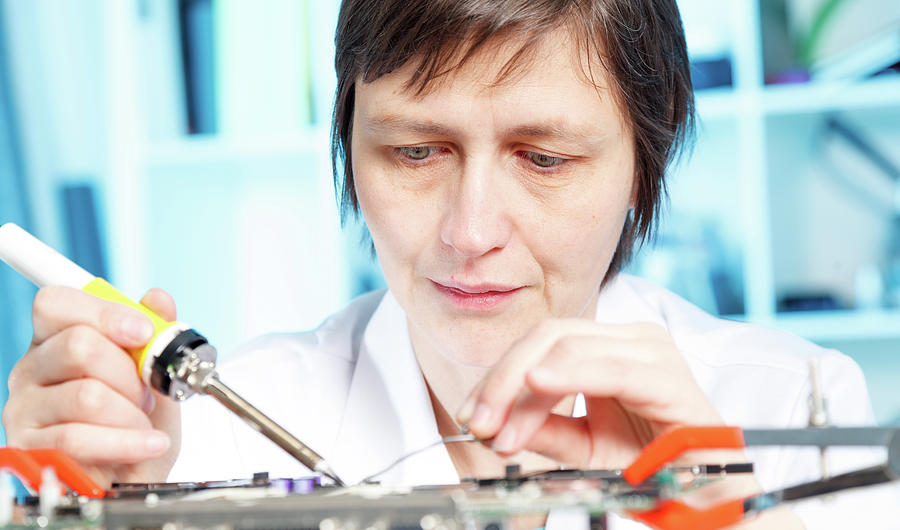 Female Photograph - Lab Assistant Working On Circuit Board by Wladimir Bulgar