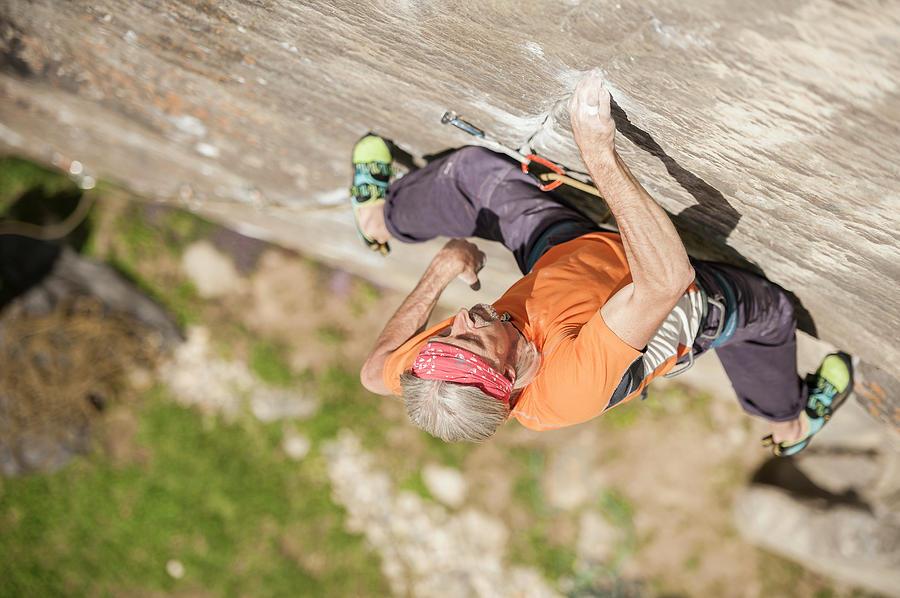 Candid Photograph - Man Climbing Re Azul, An Historic 7b by Paolo Sartori