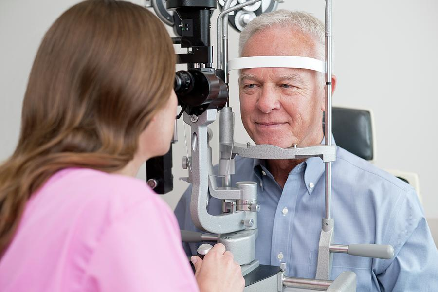 Adult Photograph - Optician Testing Mans Eyesight by Science Photo Library