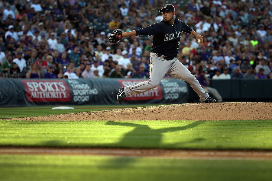 Seattle Mariners V Colorado Rockies Photograph by Doug Pensinger