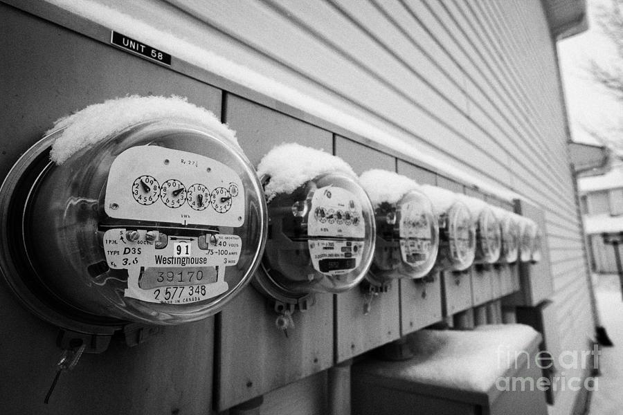 Snow Photograph - snow covered electricity meters in Saskatoon Saskatchewan Canada by Joe Fox