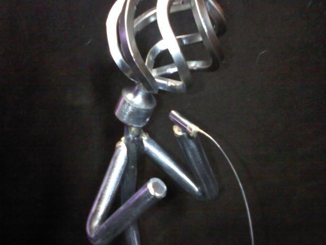 Steel Sculpture - The Singer by Dan Daugherty