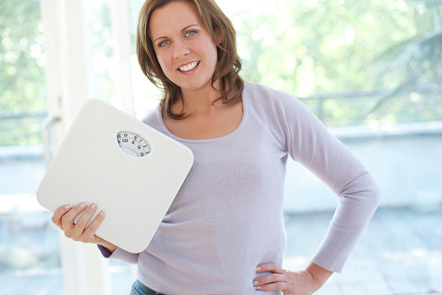 Indoors Photograph - Weight Loss by Ian Hooton/science Photo Library