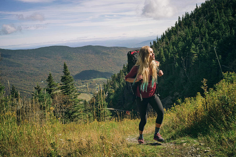 Woman Hiking On A Rocky Ridgeline Photograph by Corey Hendrickson