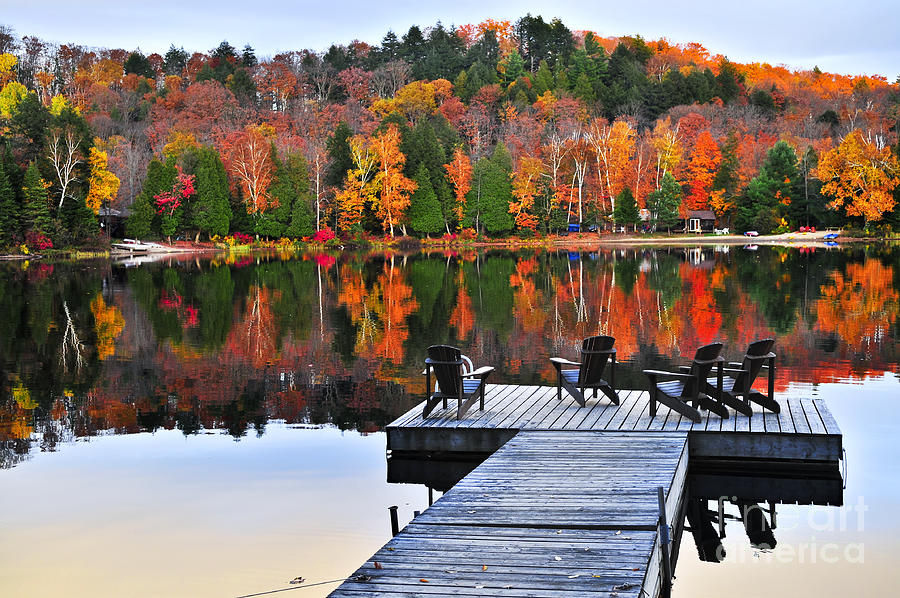 Wooden Dock With Chairs On Autumn Lake Photograph