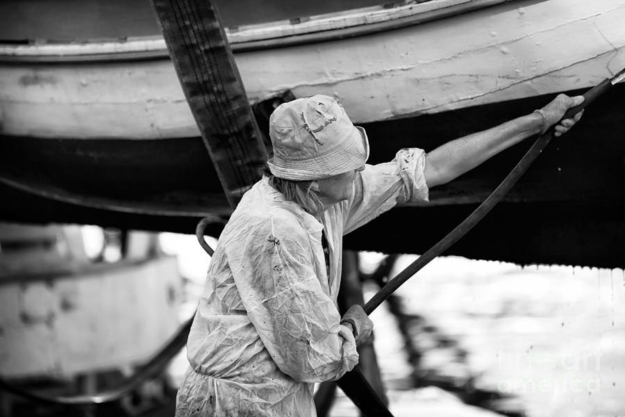 Boat Photograph - Working On The Boat by John Rizzuto