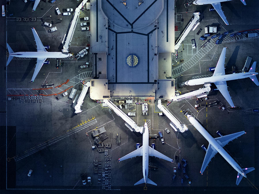 Airliners At  Gates And Control Tower Photograph by Michael H
