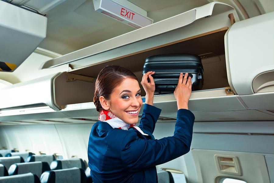 Beautiful air stewardess Photograph by Izusek